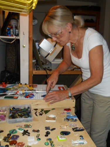 Artist Cheryl Johson works on her fused glass jewelry.